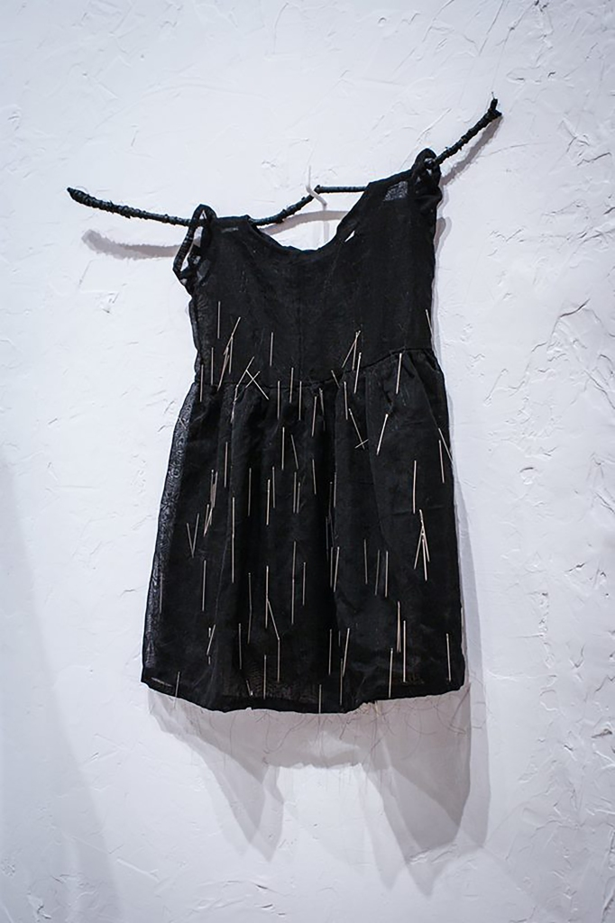 black baby dress with needles